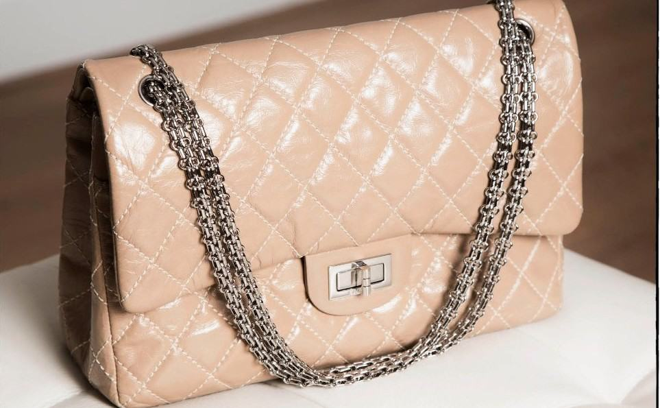 429cb21aab87 Vintage Advantage: the History of the Chanel 2.55 - Eluxe Magazine