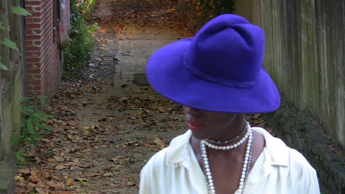 bianca_purple_hat_blurry_clear_leaves_close