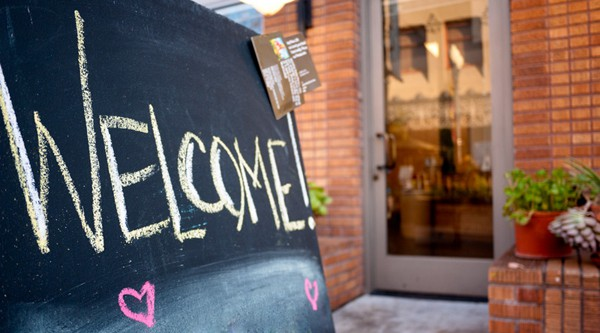 road-less-traveled-store-welcome-sign-home-page-chalkboard