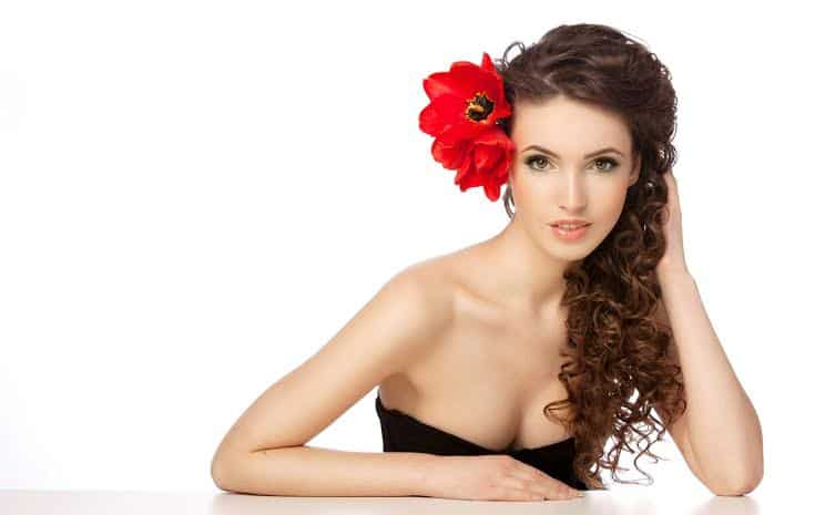 Beautiful woman with red flowers