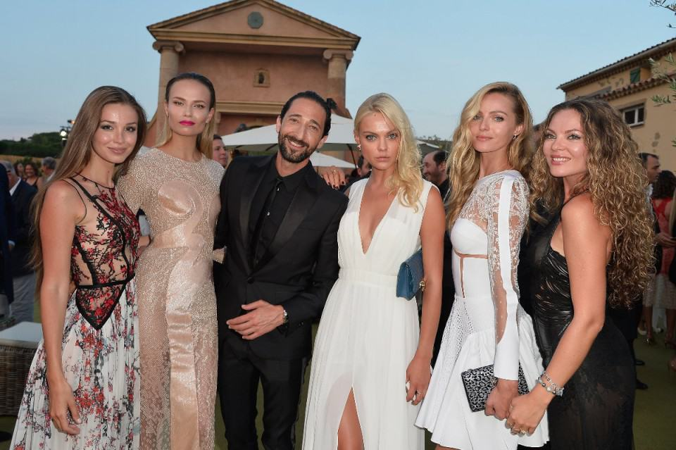 SAINT-TROPEZ, FRANCE - JULY 22: (L-R) Lara Lieto, Natasha Poly, Adrian Brody, Emily Senko and Valentina Zeylaeva attend a cocktail during The Leonardo DiCaprio Foundation 2nd Annual Saint-Tropez Gala at Domaine Bertaud Belieu on July 22, 2015 in Saint-Tropez, France.  (Photo by Handout/Getty Images)