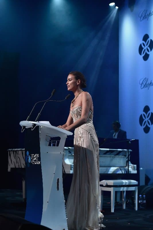SAINT-TROPEZ, FRANCE - JULY 22:  Irina Shayk speaks on stage Dinner and Auction during The Leonardo DiCaprio Foundation 2nd Annual Saint-Tropez Gala at Domaine Bertaud Belieu on July 22, 2015 in Saint-Tropez, France.  (Photo by Handout/Getty Images)