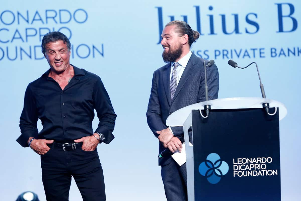 SAINT-TROPEZ, FRANCE - JULY 22:  Sylvester Stallone and Leonardo DiCaprio speak onstage at a Dinner and Auction during The Leonardo DiCaprio Foundation 2nd Annual Saint-Tropez Gala at Domaine Bertaud Belieu on July 22, 2015 in Saint-Tropez, France.  (Photo by Handout/Getty Images)