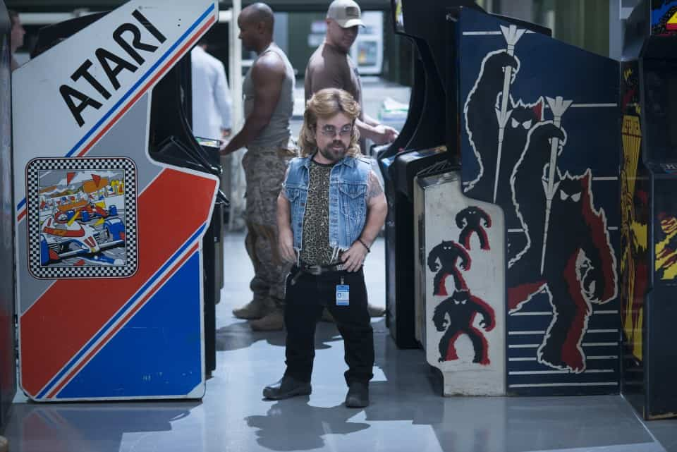 Eddie (Peter Dinklage) plays Pole Position and Space Invaders simultaneously in Columbia Pictures' PIXELS.