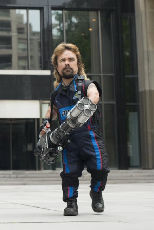 Eddie (Peter Dinklage, right) battle a number of arcade game creatures on the streets of Washington, DC in Columbia Pictures' PIXELS.