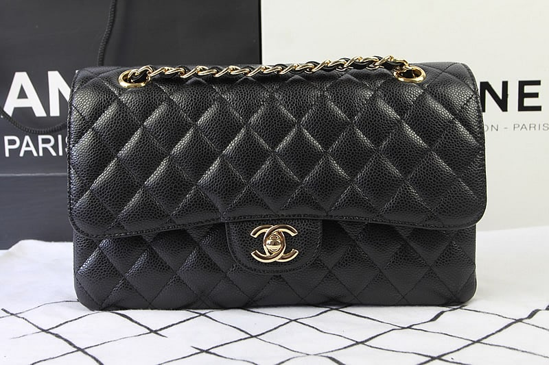 55584e6d9396 Vintage Alert  How to Spot a Fake Chanel Flap Bag - Eluxe Magazine