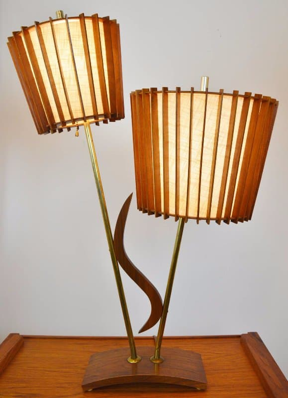 Image: https://www.1stdibs.com/furniture/lighting/floor-lamps/pair-of-mid-century-modern-walnut-teak-brass-double-headed-lamps/id-f_2732802/