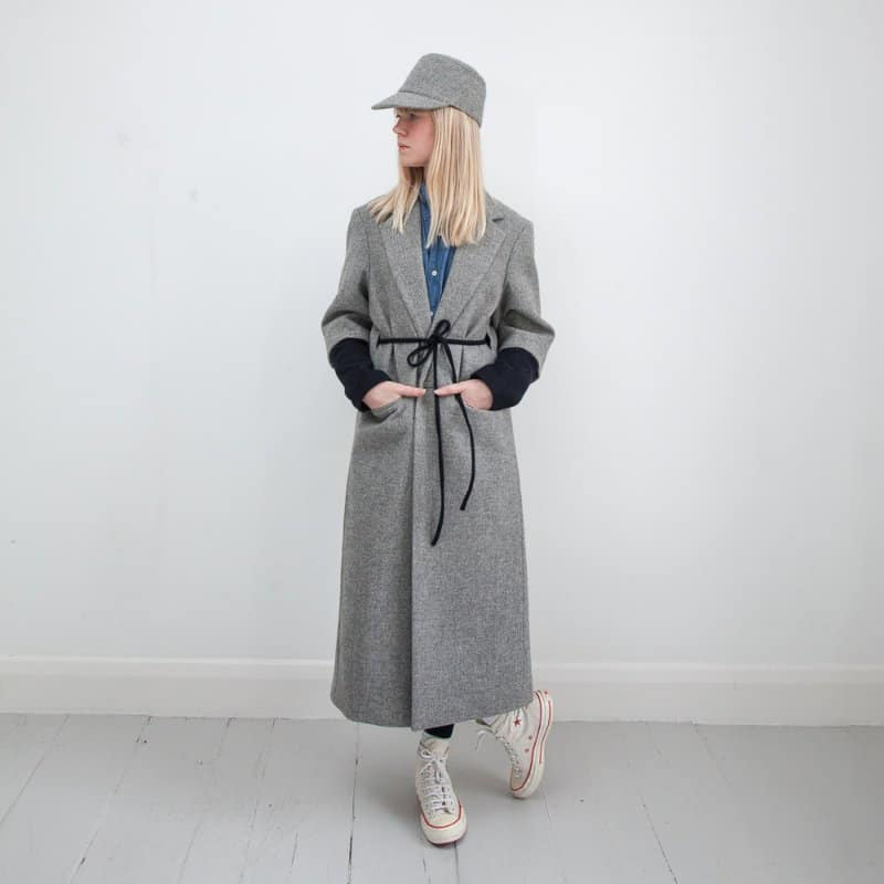 model wearing project4 versatile coat with belt front view