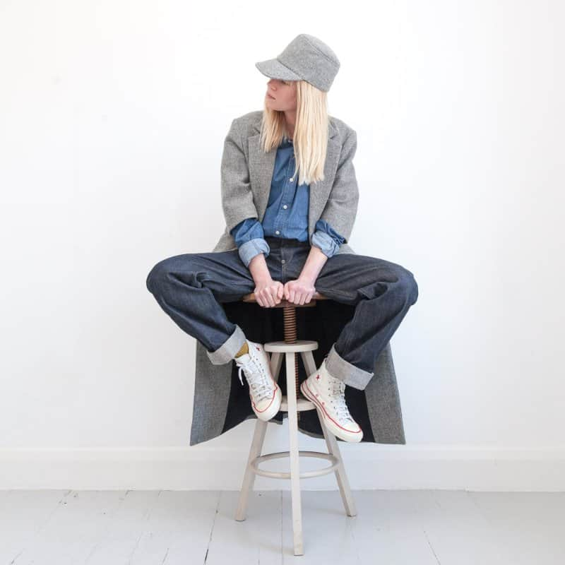 project 4 versatile coat with model sitting on chair