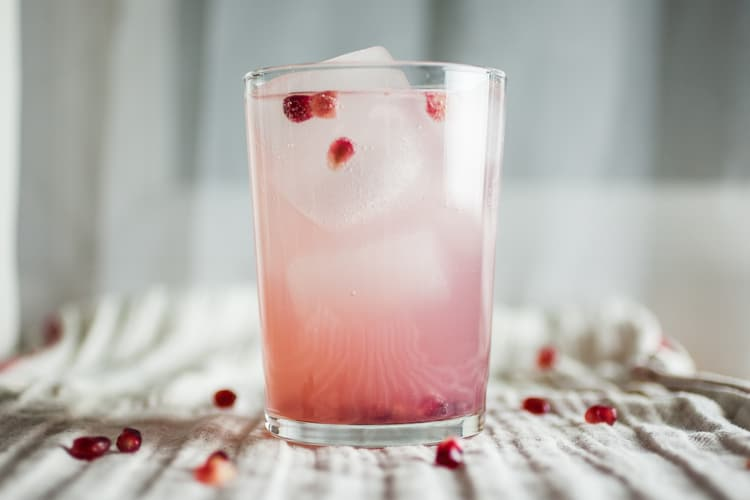 Produce+On+Parade+-+Pomegranate+Gin+Fizz+&+G'Vine+Review+-+Blended+with+fresh+pomegranate+seeds+and+a+floral+gin+made+from+grapes.+Topped+with+fuzzy+water,+this+is+the+perfect+lightly+scented+adult+beverage+to+sip+o